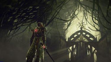 Cinématique. Un héros armé d'une épée s'approche d'une immense porte antique sculptée.