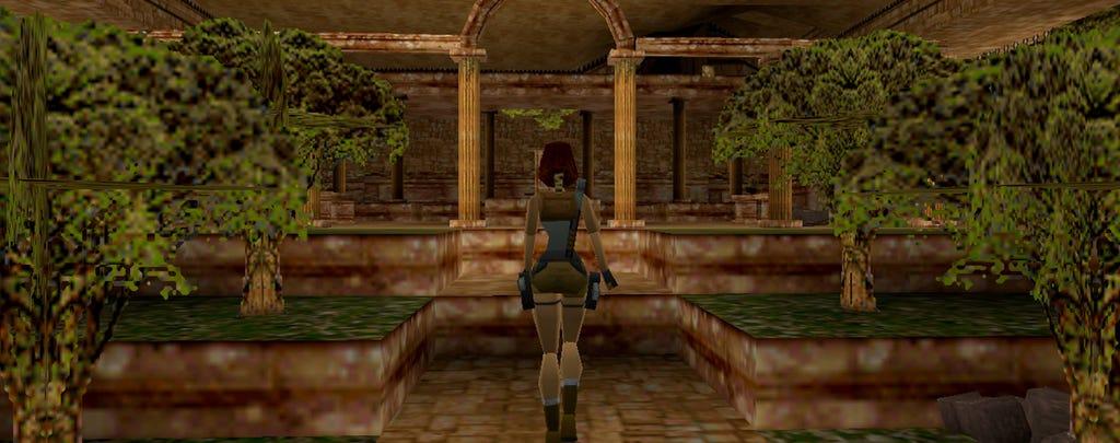 A screenshot from 1996 Tomb Raider of Lara inside temple ruins