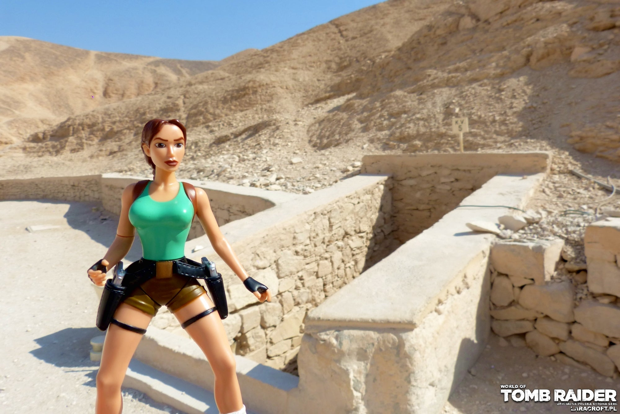 A photograph of a Lara Croft figure in front of ruins in Egypt