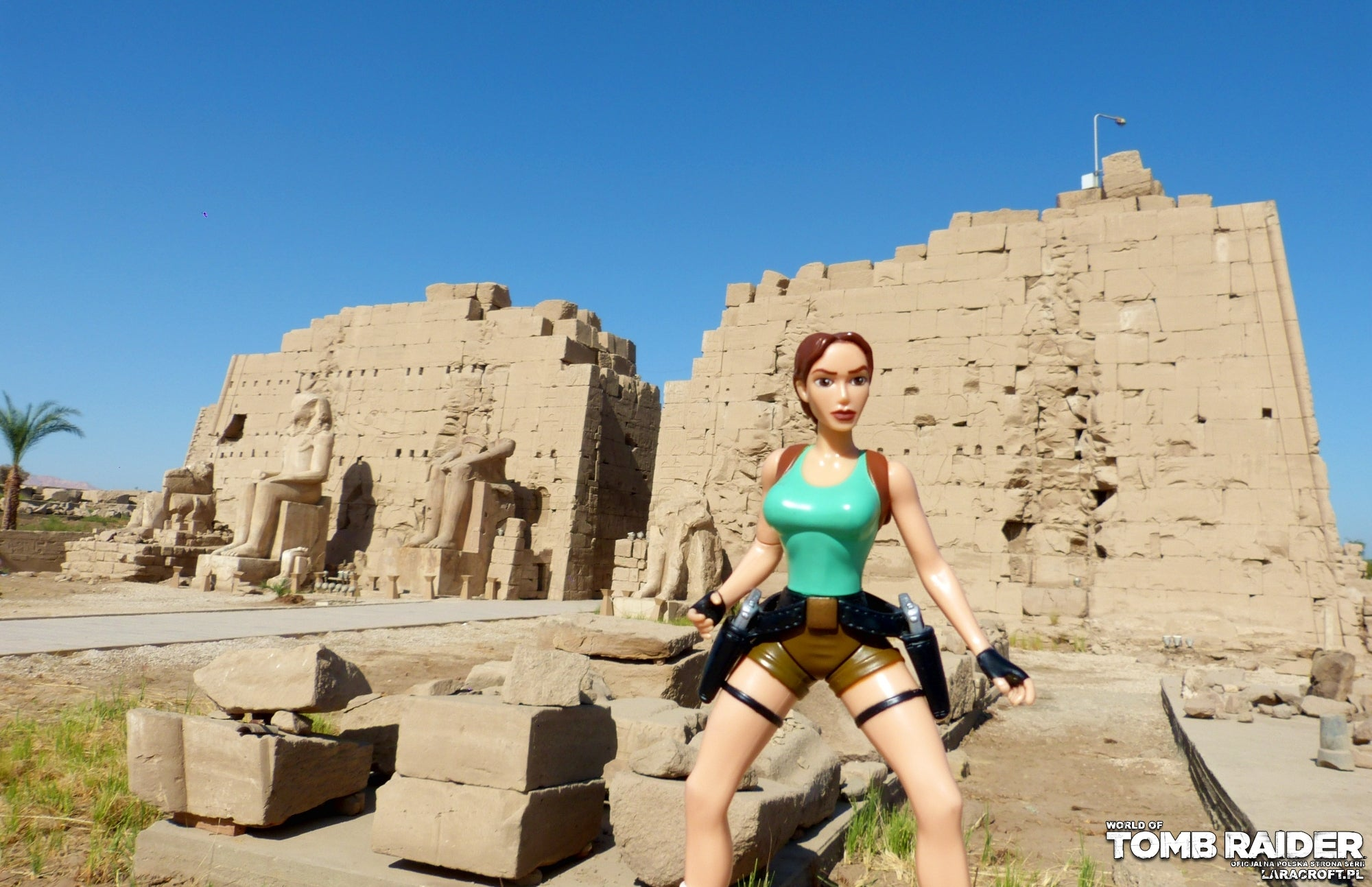 A photograph of a Lara Croft figure in front of the Temple of Karnak in Egypt