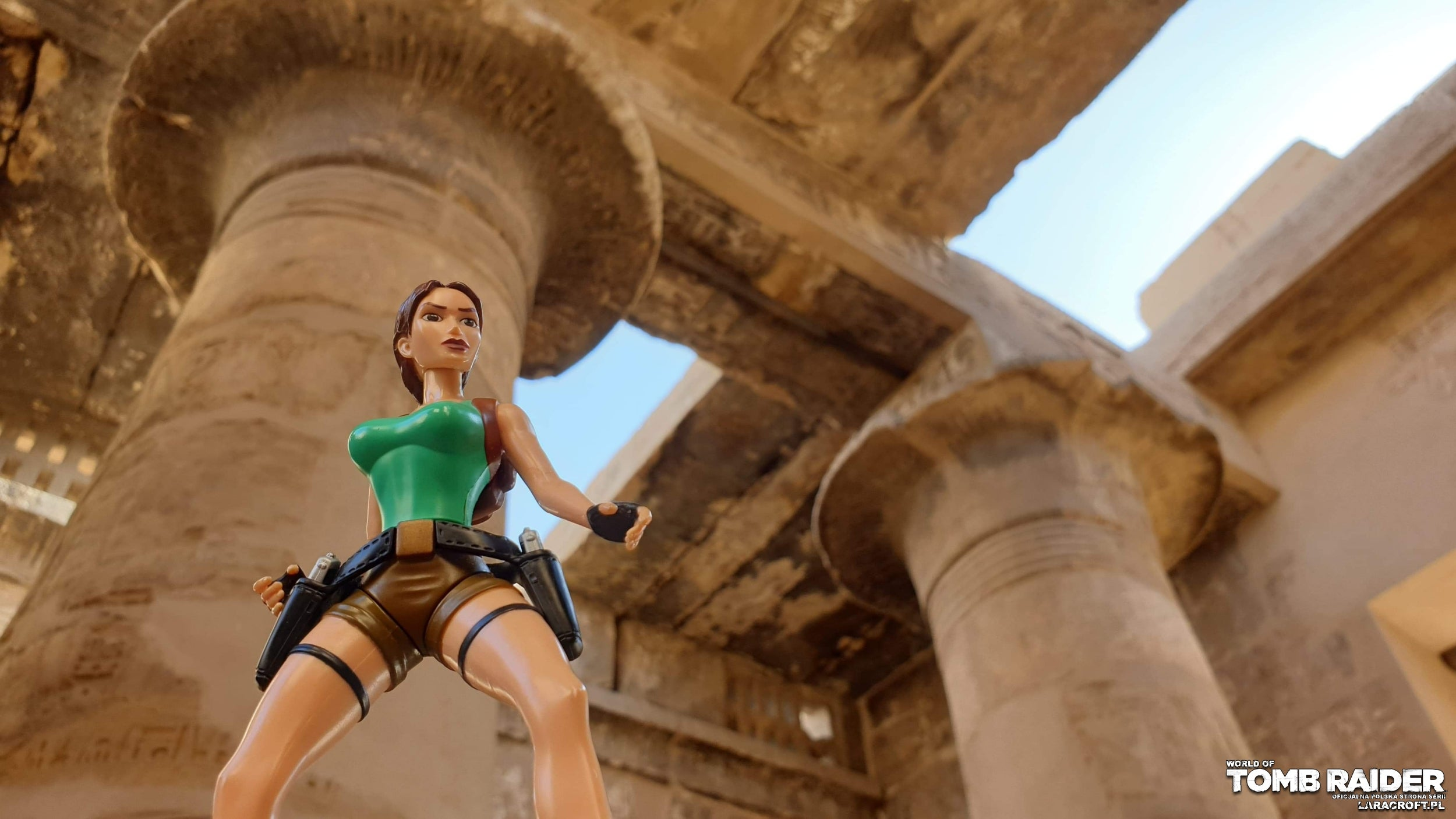 A photograph of a Lara Croft figure in front of the Great Hypostyle Hall in Egypt