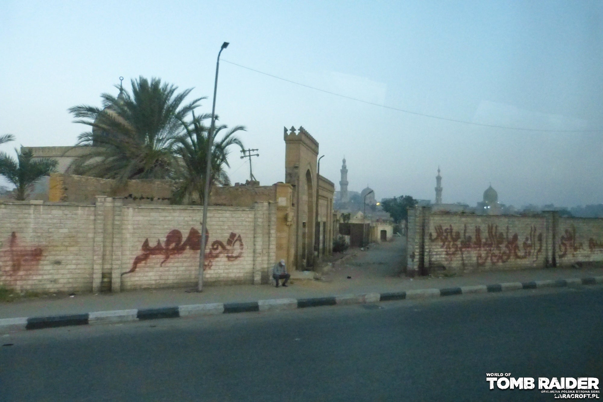 A photograph of a Lara Croft figure in front of Cairo in Egypt