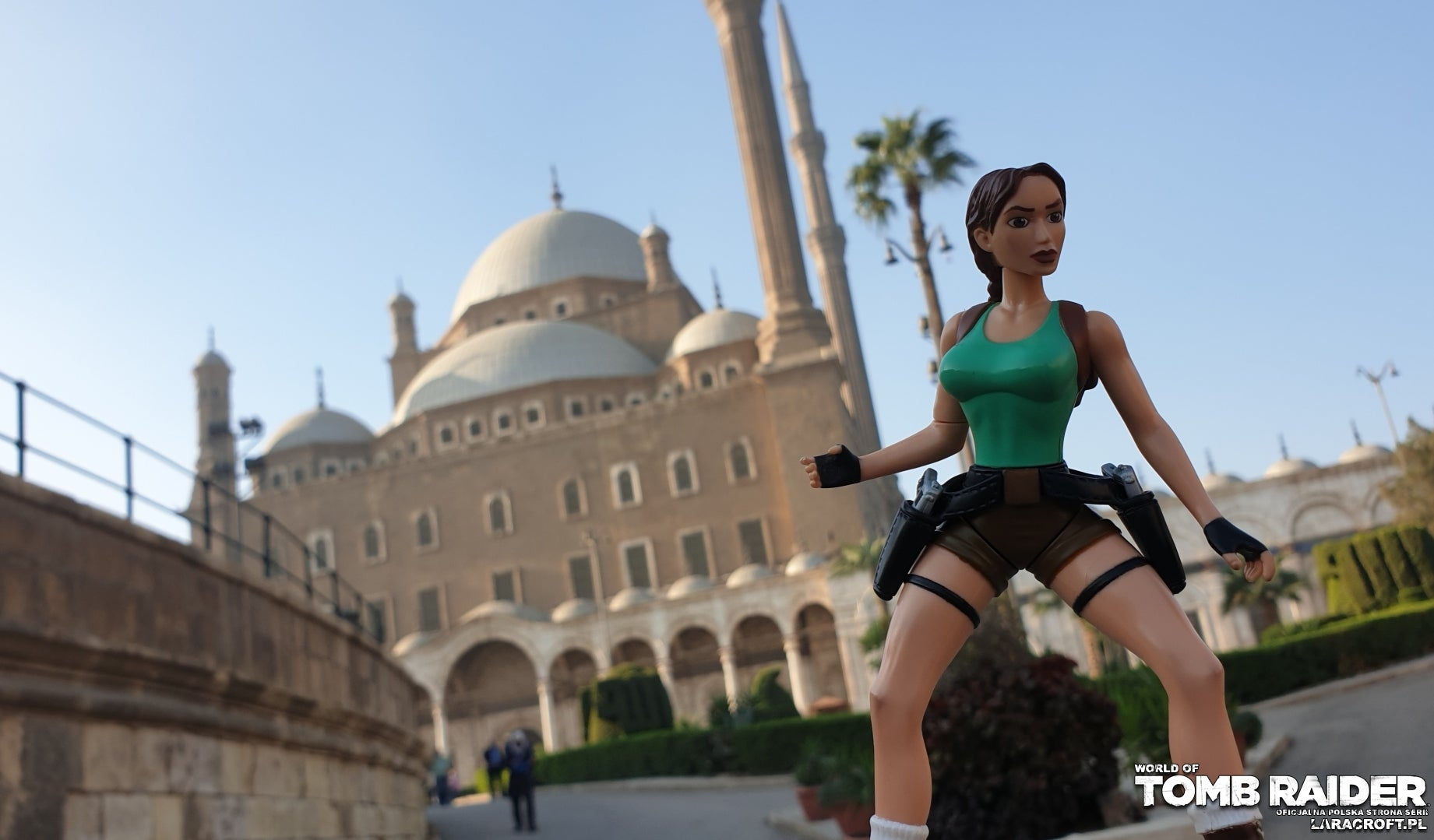 A photograph of a Lara Croft figure in front of Cairo's Citadel gate in Egypt
