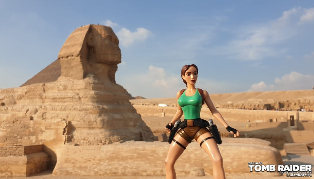 A photo of a Lara Croft figure in front of the Sphinx in Egypt