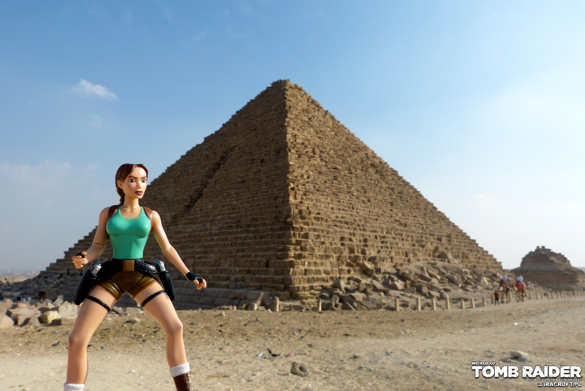 A photograph of a Lara Croft figure in front of a pyramid in Egypt
