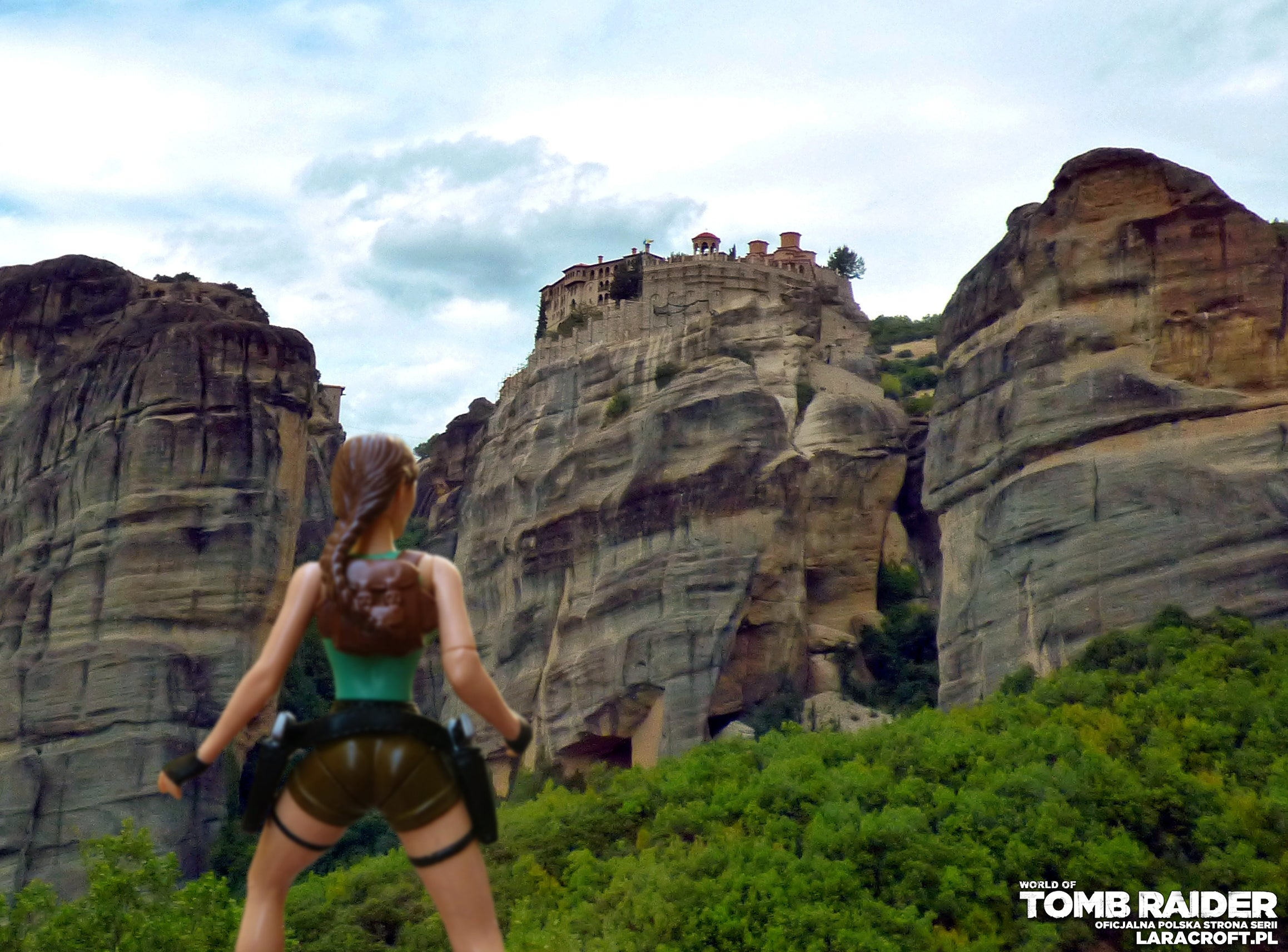 A photograph of a Lara Croft figure in front of the Meteora in Greece