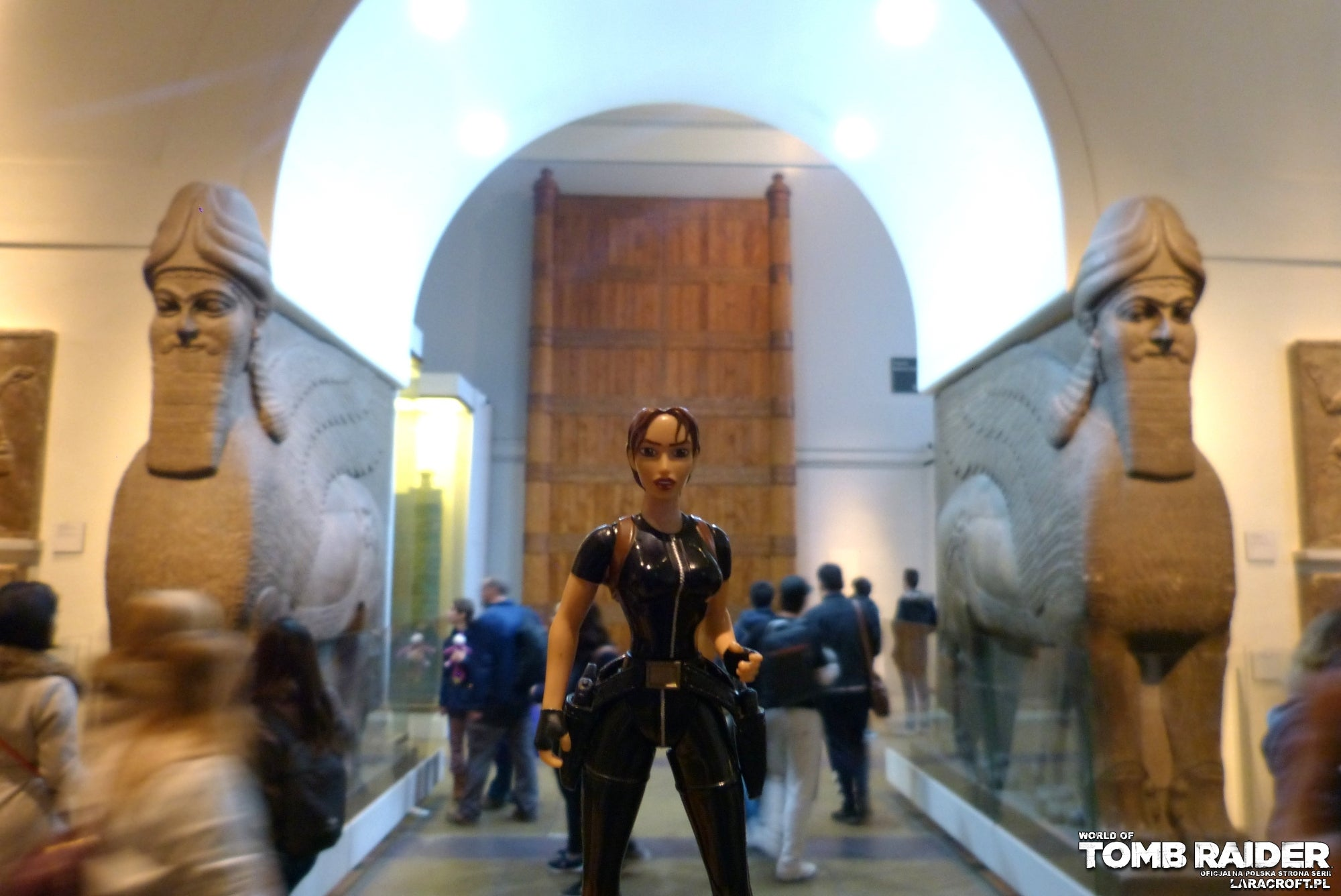 A photograph of a Lara Croft figure inside the Natural History Museum
