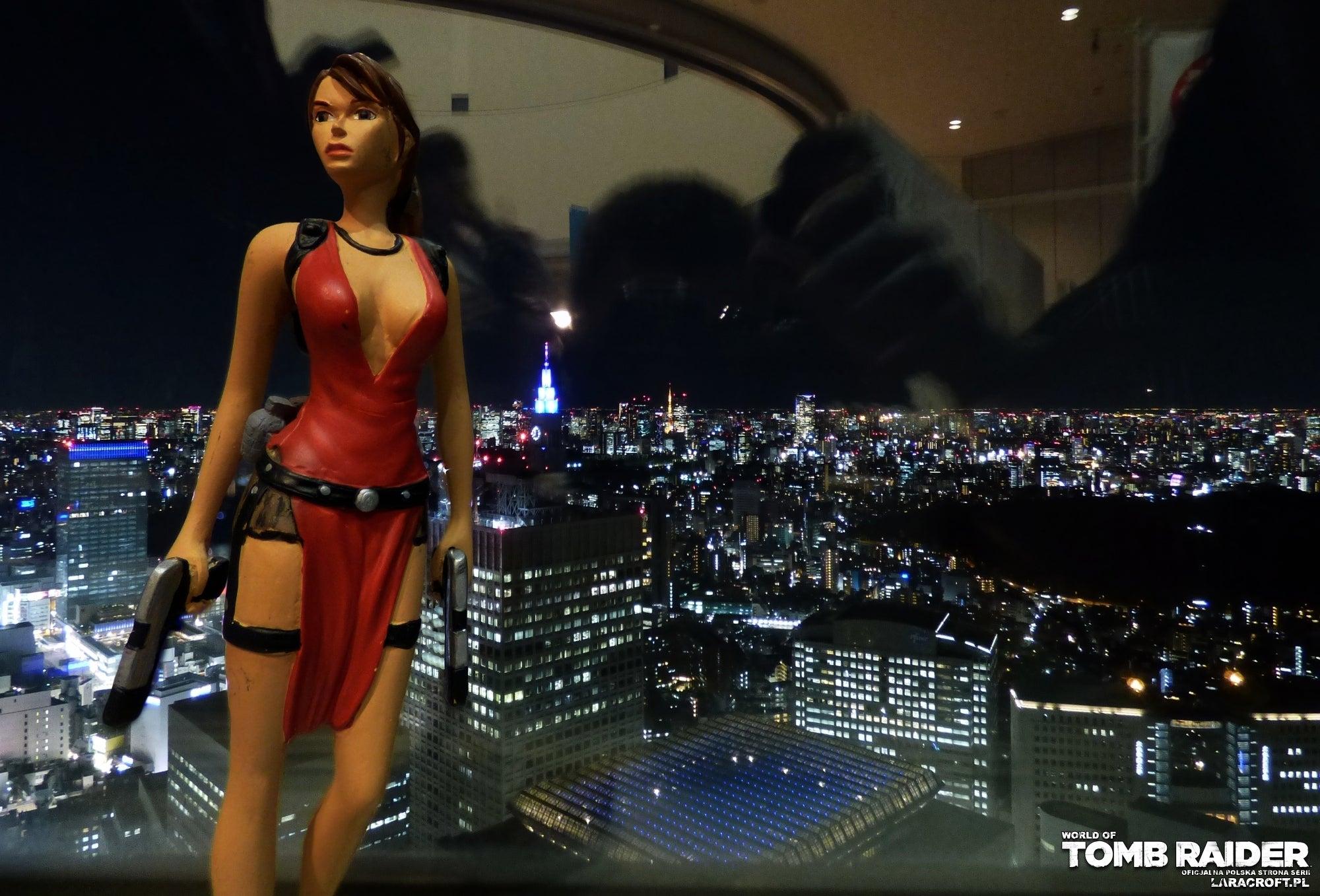 A photograph of a Lara Croft figure inside a skyscraper in Tokyo