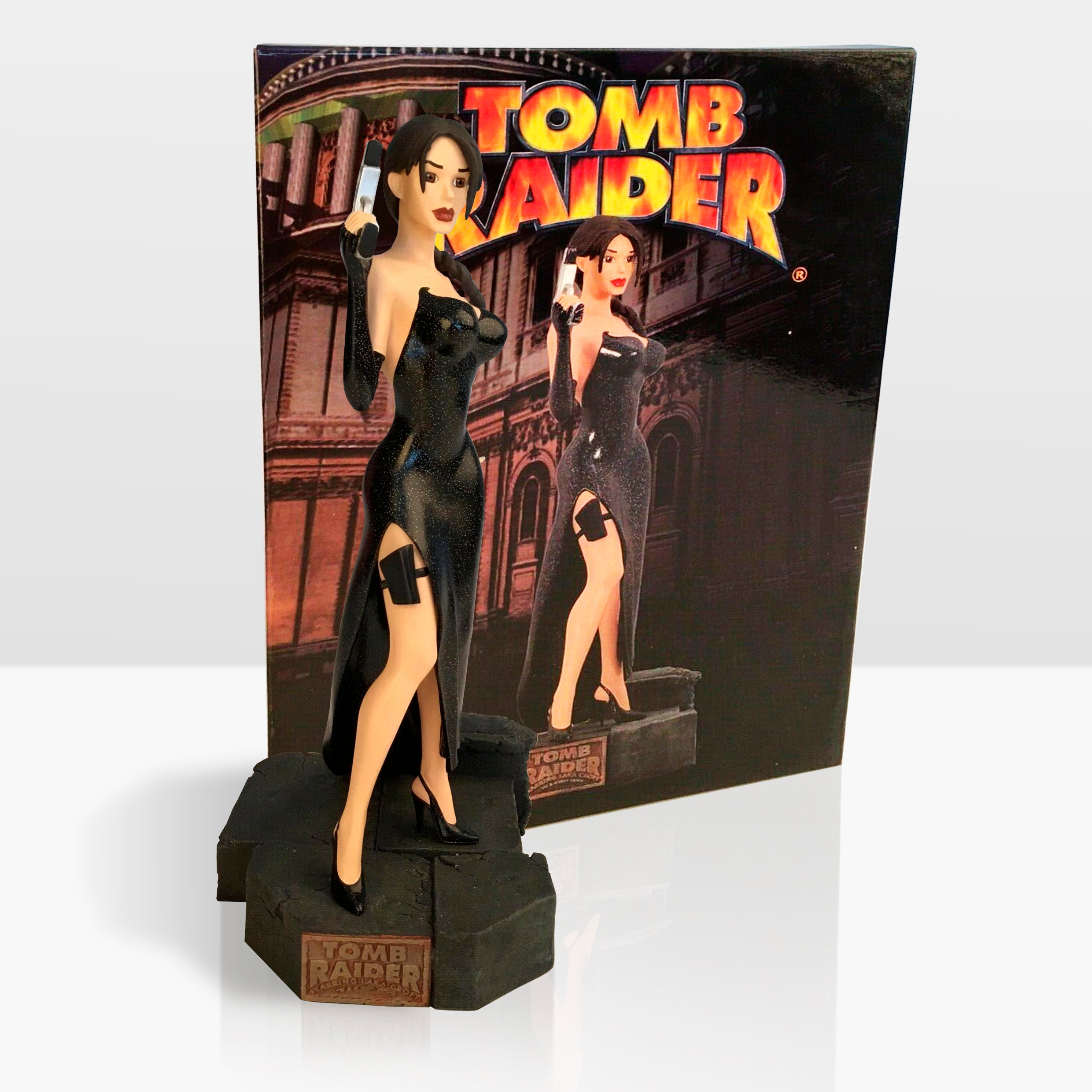 A Lara Croft action figure standing against a backdrop insert of the figure. Lara is wearing the ballgown outfit from Tomb Raider Chronicles.