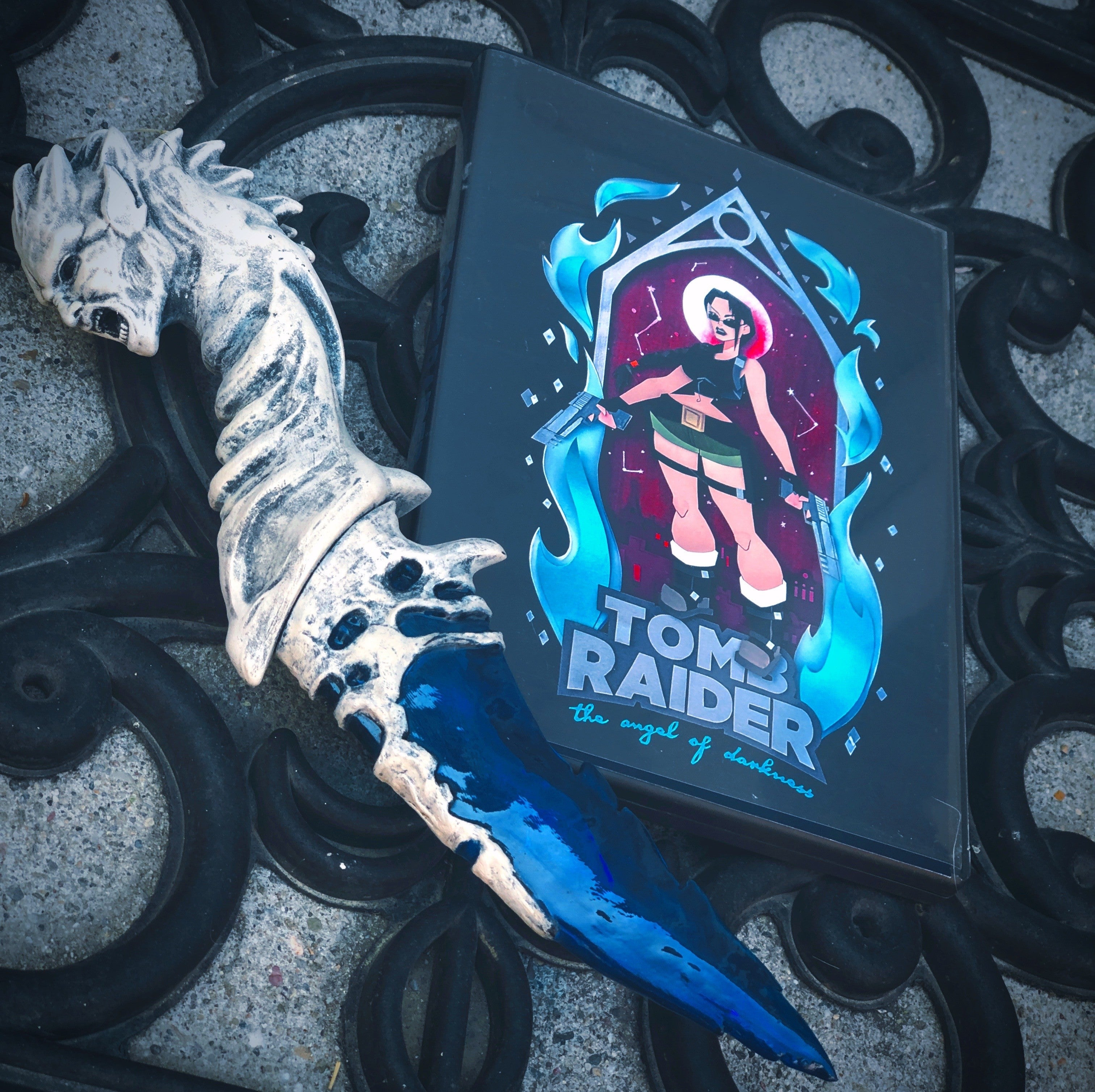 A photograph of Caleb's box art next to an artifact from The Angel of Darkness.