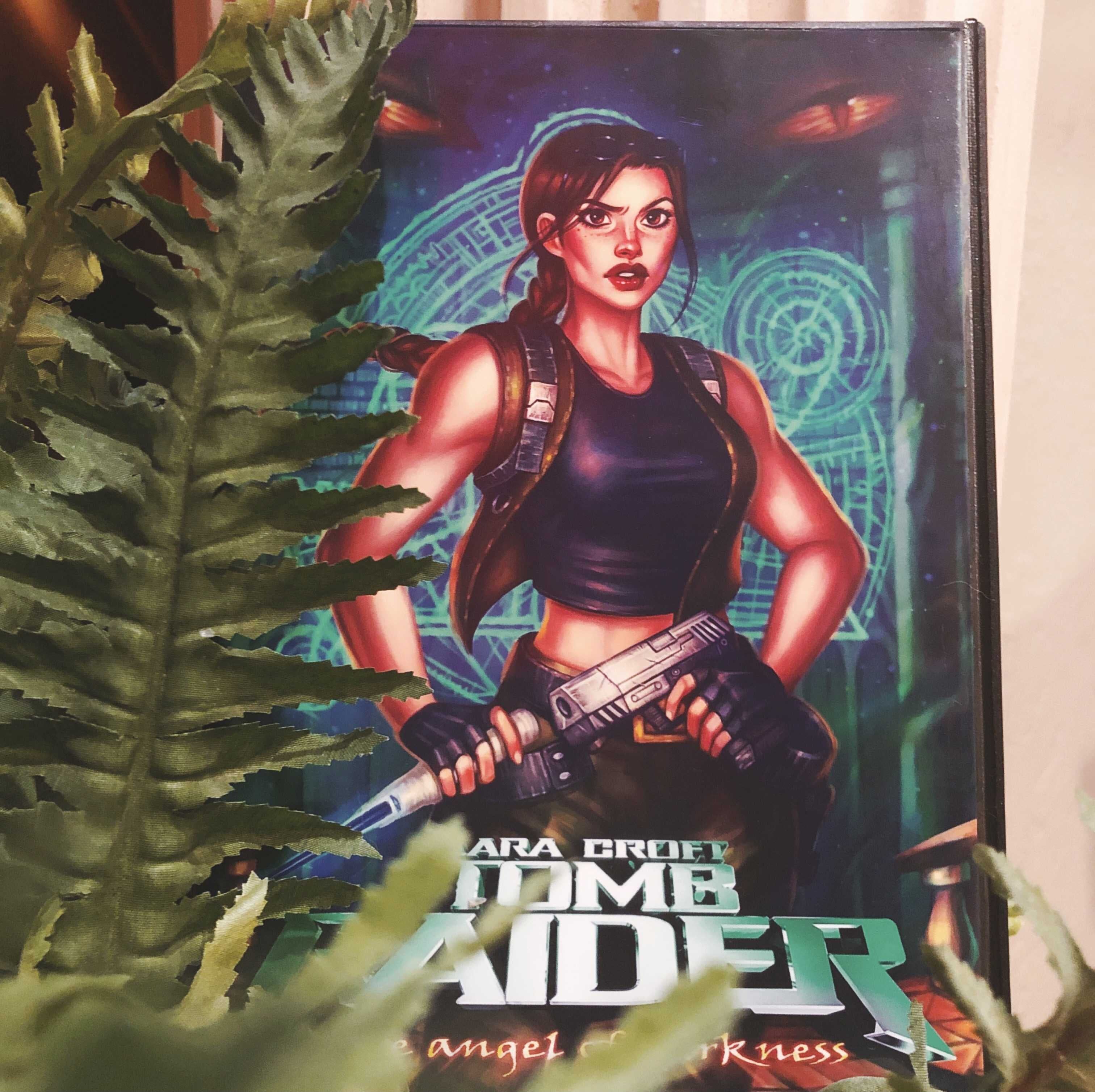 A photo featuring Anastasia Ershova's box art reimagining for Tomb Raider: the Angel of Darkness printed and inserted in a PlayStation 2 case