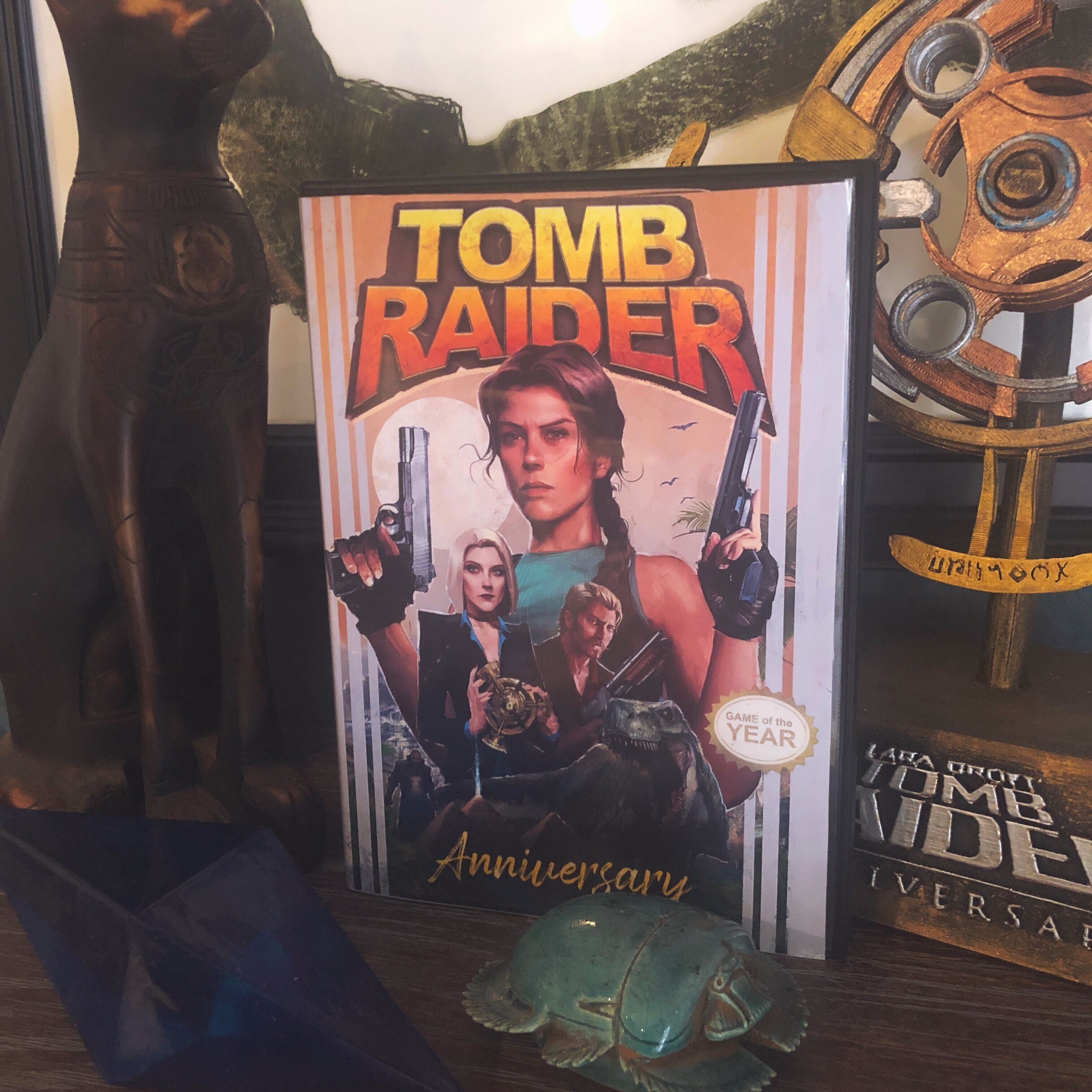 Brenoch's box art reimagining printed and inserted into a PlayStation 2 case. It is surrounded by props like the Anniversary scion