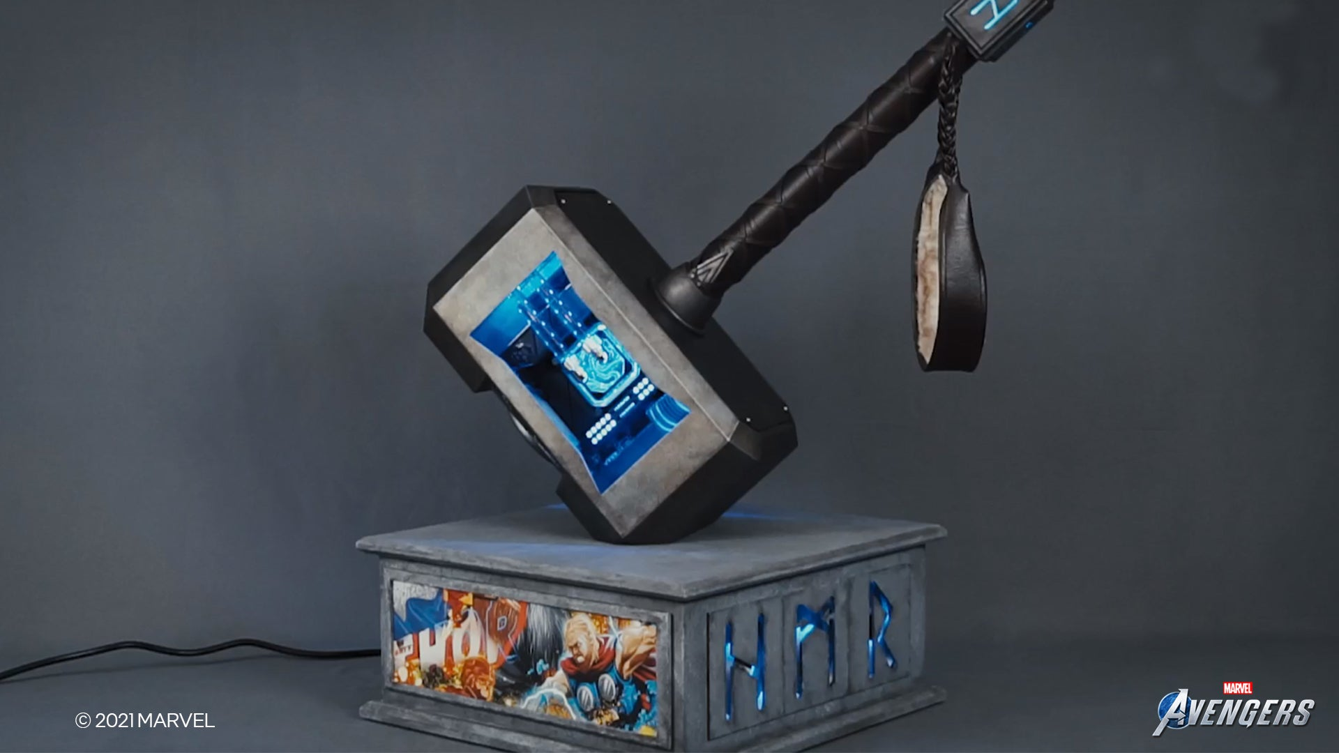 A PC computer that looks like Thor's hammer Mjolnir resting atop a stone slab.