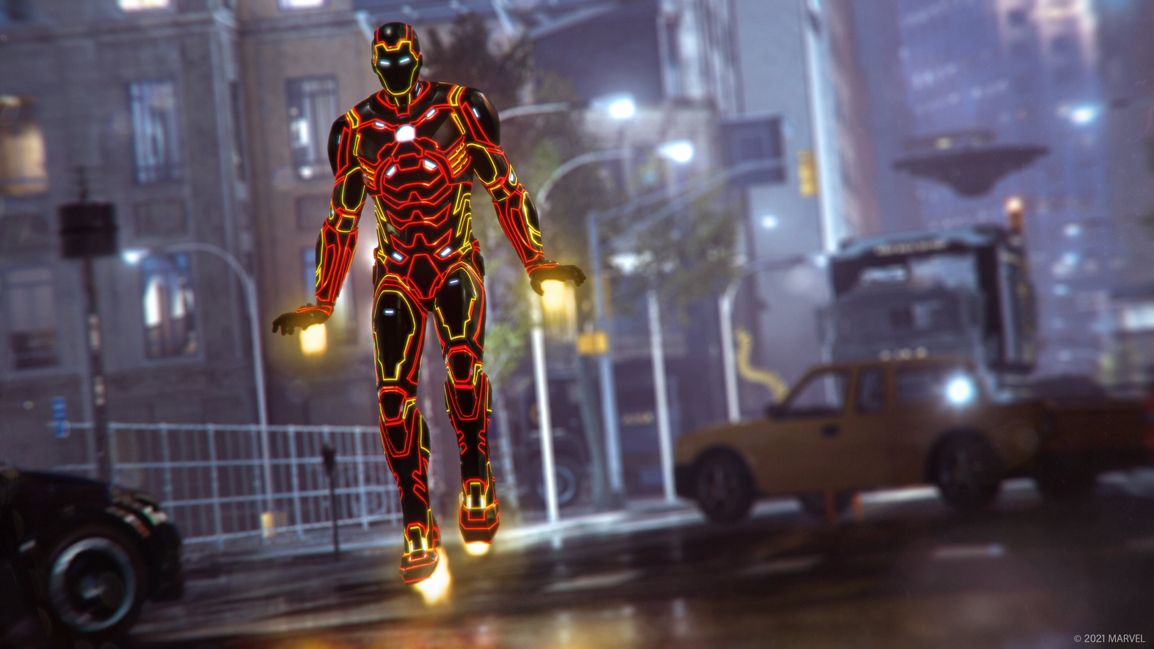 Iron Man hovers above the city street in the laser-bright piping of the Monatomic outfit.
