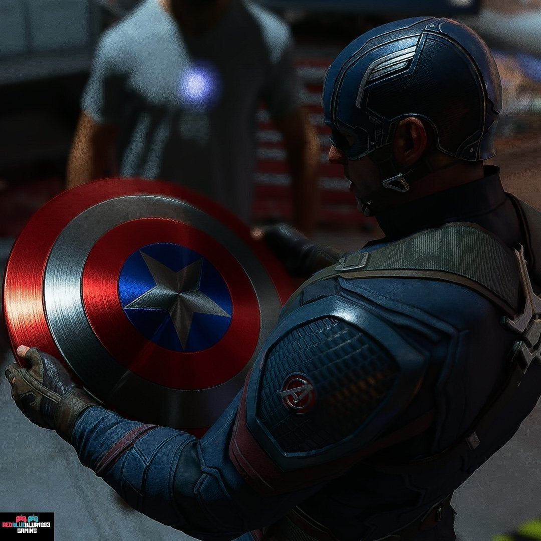 A screenshot of Captain America as he looks at his red, white, and blue-striped vibranium shield