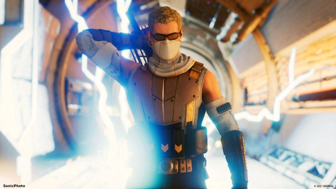 A screenshot of Hawkeye in his sharpshooter glasses, reaching over his shoulder to grab an arrow from his quiver. An explosion of electricity behind him.