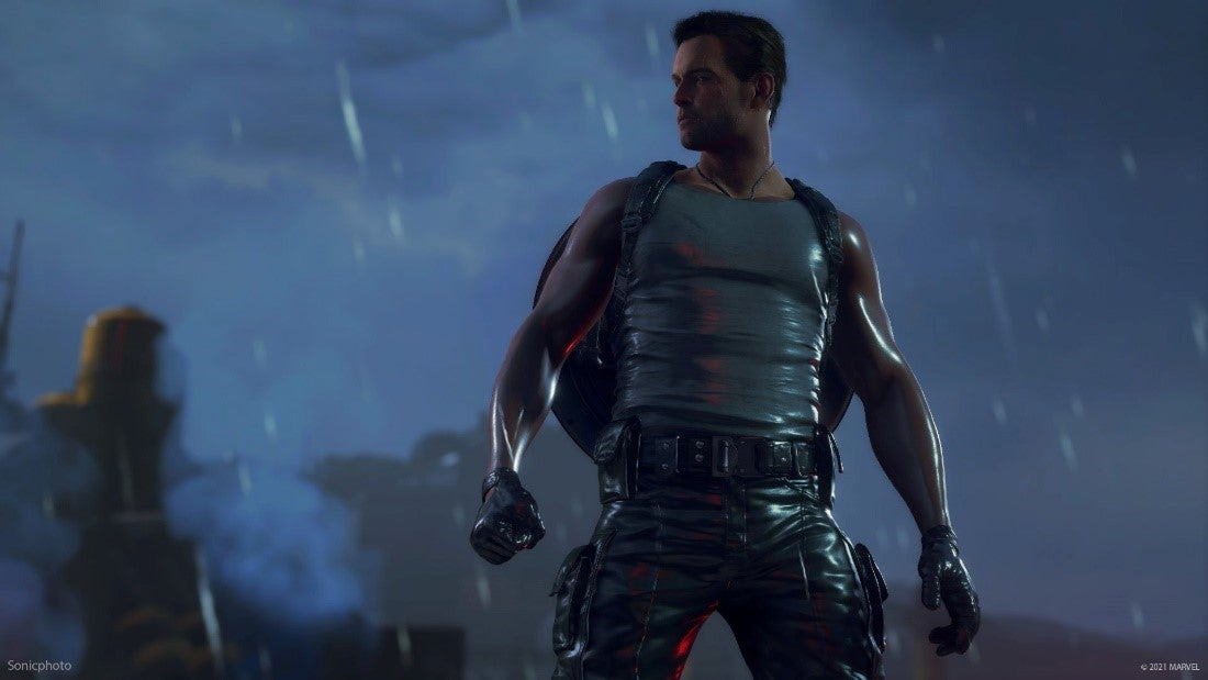 Steve Rogers stands in the rain in just a tank top. His red, white, and blue vibranium, shield is fastened to his back.