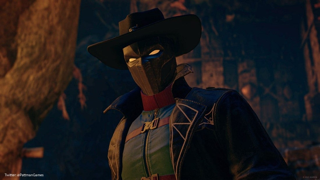 A Community screenshot of Black Panther wearing a cowboy hat and a jacket with a high, arching collar. He stands at the base of a cliff. Old Wakanda ruins are embedded into the cliff face behind him.
