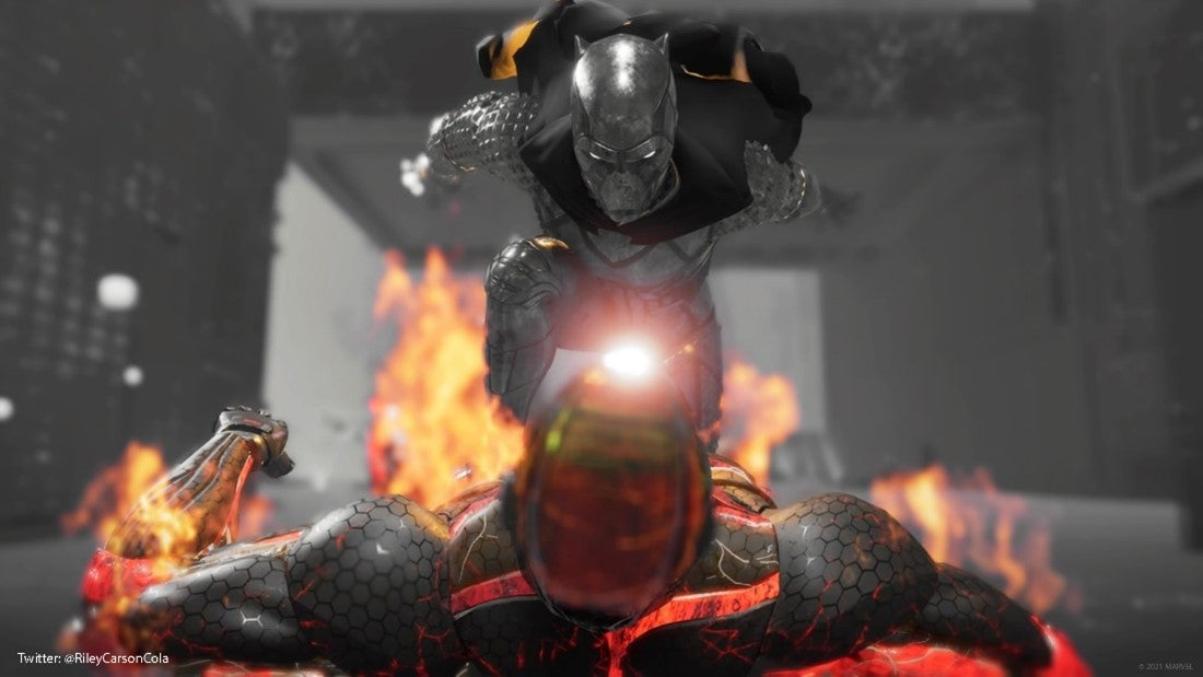 The Black Panther kicks a flaming robot in the head with his knee, lunging forward through the grayscale HARM room.