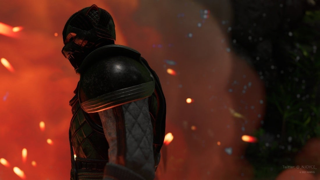 A screenshot of Black Panther. His silhouette is black against the flames behind him, and the orange and red cinders that float down from above.