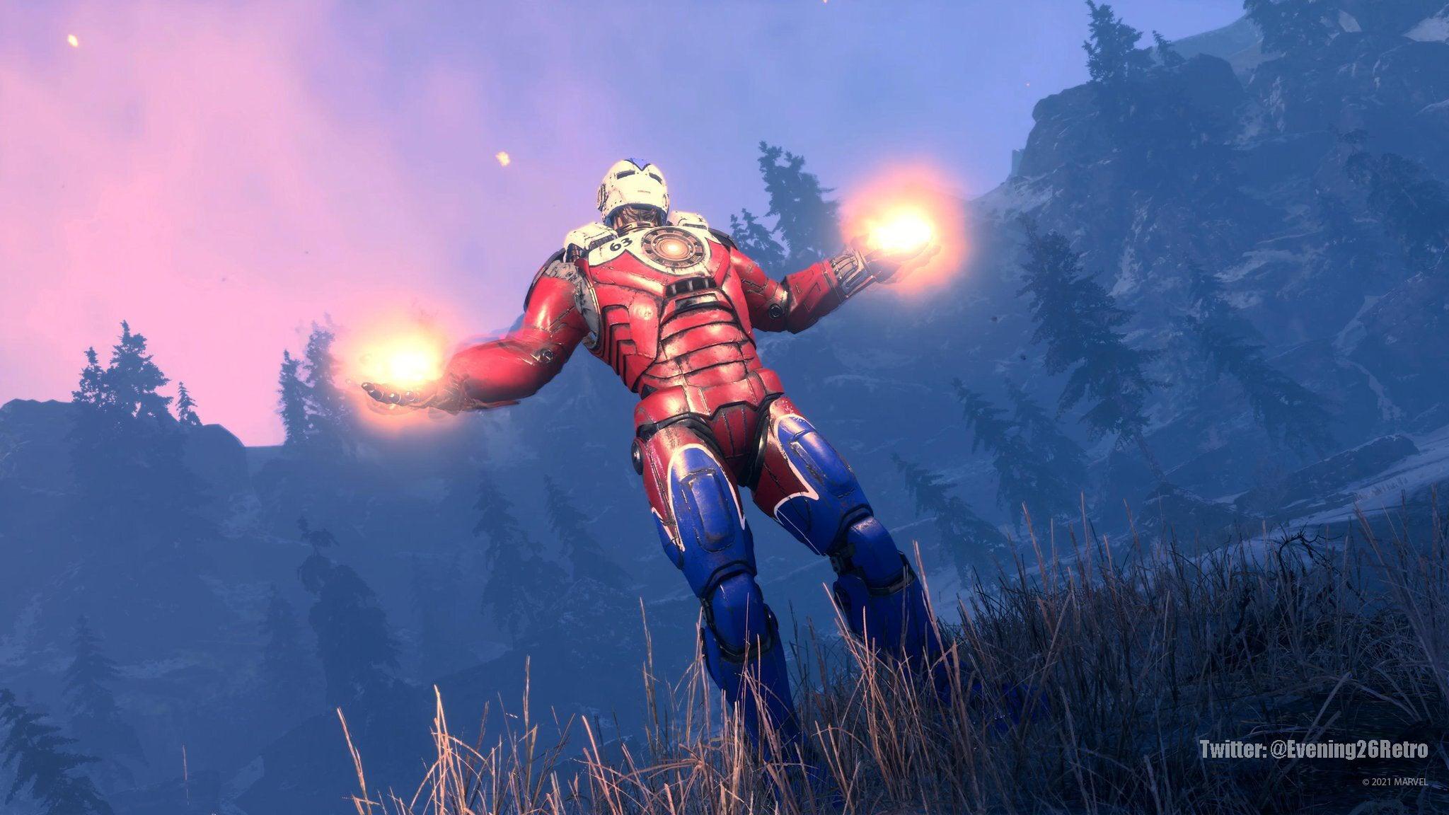 Iron Man con el atuendo Aleación de hierro. Las piernas son azules; la pechera, roja; y las hombreras y el casco, chapados en blanco. Vemos a Iron Man sobre el terreno, con los brazos extendidos a los lados. Los guanteletes, preparados con energía, como si estuviese provocando al enemigo.