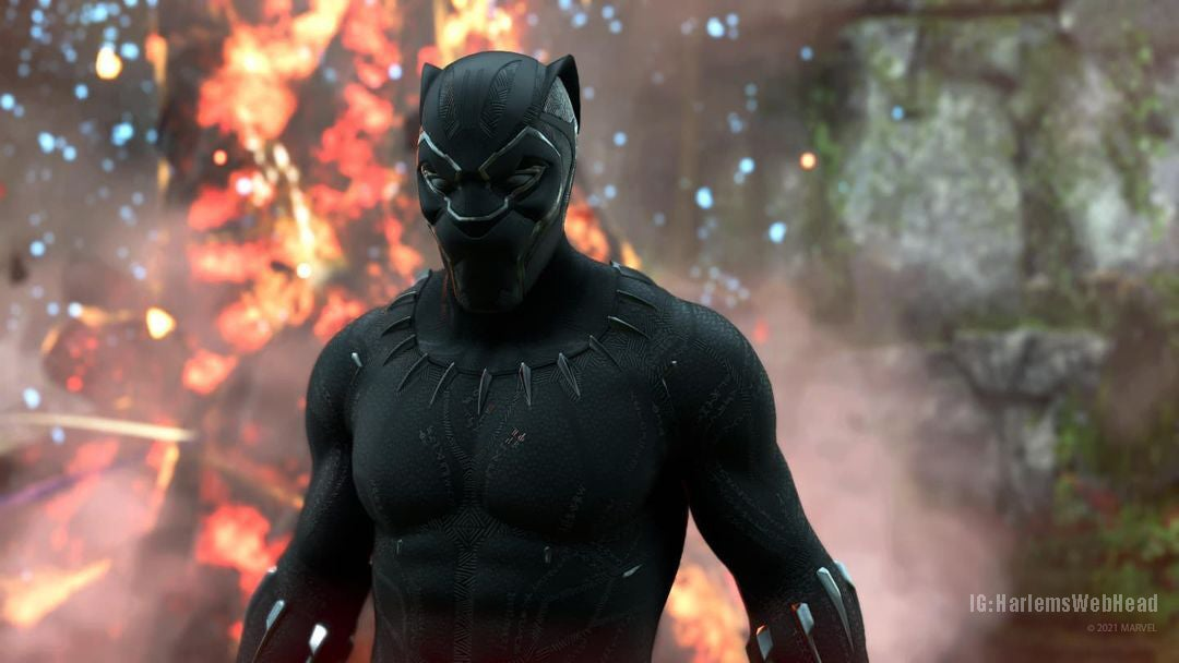 A screenshot of Black Panther in his form-fitting black MCU-inspired Outfit. He stands in the jungle – a fire burning behind him. He stands still, as if surveying the landscape for enemies.